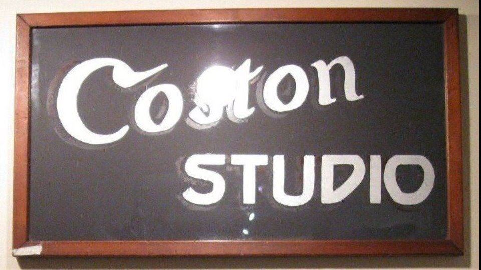 Coston Studio sign mae from wood and painted glass